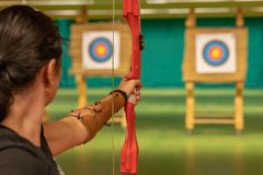 Archery in the sports hall. Competition for the best shot an arrow into targets. Tournament royalty free stock photo