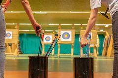 Archery in the sports hall. Competition for the best shot an arrow into targets. Tournament stock photo