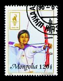 Archery, Summer Olympics 1996, Atlanta serie, circa 1996. MOSCOW, RUSSIA - NOVEMBER 26, 2017: A stamp printed in Mongolia shows Archery, Summer Olympics 1996 Stock Image