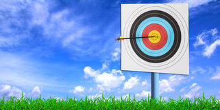 Archery target with arrow Stock Photos