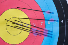 Archery target with arrows on it Royalty Free Stock Photography