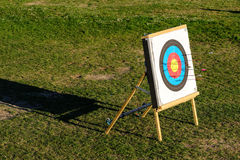 Archery target with arrows Stock Photo