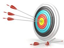 Archery target with red arrows in the center Stock Photo