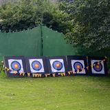 Archery targets at a fete or. Five archery targets are in a row on the grass at a fete/fair Stock Photography
