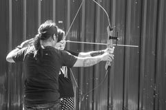 Archery teaching. Trainer teaching archery for girl royalty free stock images