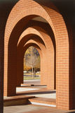 Arches. Red brick architectural arches in downtown Colorado Springs on the rocky mountain plaza with bronze statue in background royalty free stock photography