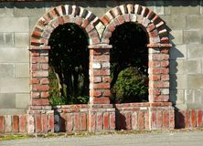 Arches. Italianate style arches in garden wall Royalty Free Stock Image