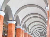 Arches. Row of illuminated arches in an old restored building in Cagliari, Italy royalty free stock photo