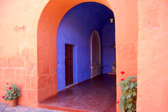 Arches. Orange and blue house and arches in Peru Stock Photography
