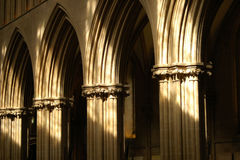 Arches. Cathedral arches lit by sunlight Royalty Free Stock Photography