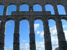 Arches against clear blue sky. Ancient aqueduct arches against clear blue sky in Spain stock photos