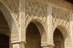 Arches in the Alhambra. Details of column and arches decorating palaces inside the Generalife gardens, inside the Alhambra complex in Granada, Spain. The walls Royalty Free Stock Images