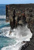 Arches along Big Island Coastline. Arches have formed under cliffs edge along the Hawaii Volcanoes National Park's coastline on the Big Island Royalty Free Stock Photos