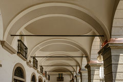 Arches of arcade at Classical Town Hall, Aosta, Italy. Arches under arcade of Town Hall Classical building , shot on a bright summer day at Aosta mountain town Stock Photos
