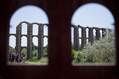 Arches from the arches. View of Roman Aqueduct Los Milagros from the memorial plaque with arches shape . Extremadura, Spain Stock Images