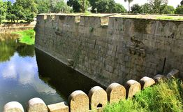 Arches of the big castle wall with trench  landscape. The big castle wall arches with trench landscape at Vellore. this fort is a 16th-century fort situated in Stock Image