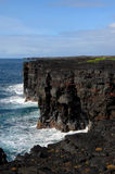 Arches on Big Island. Arches form, in the hardened lava cliffs, from pounding waves along the shore of Hawaii Volcanoes National Park Stock Photo