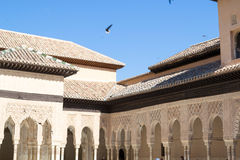 Arches with a blue sky. Alhambra palace located in Granada (Spain) is a master pice of the Islamic/Muslim Architecture in Europe Royalty Free Stock Image