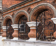 Arches in brick architectural detail with ornamental wrought iron grill work  on street in Yaroslavl, Russia Royalty Free Stock Photo