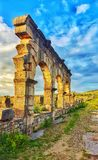The arches and buildings of volubilis are known in Roman and Greek civilization stock photography