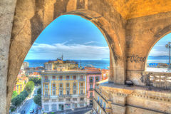 Arches in Cagliari. Caglairi harbor seen through Saint Remy arches Stock Image