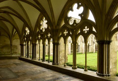 Arches of Cathedral cloister , Salisbury. Foreshortening of mullions and decoration of large cloister alongside famous Gothic church Royalty Free Stock Photo