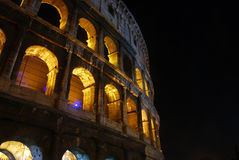 The arches of the Colosseum at night Stock Photo