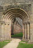 Arches & Columns. Fountains Abbey near to Ripon in North Yorkshire, England. The remains of a Cistercian monastery, and the largest Abbey ruins in England Royalty Free Stock Images