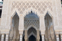Arches and columns. Alhambra palace located in Granada (Spain) is a master pice of the Islamic/Muslim Architecture in Europe Royalty Free Stock Photo