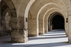 Arches and columns in Sultanhani caravansary on Stock Photography