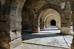 Arches and columns in Sultanhani caravansary on Royalty Free Stock Photo