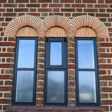 Arches. Detail of beautiful arches above windows Stock Image