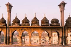 Arches and domes of sandstone mughal architecture. Arches and domes with pillars at Bara imambara in lucknow uttar pradesh india shot at sunset. The roof of this Royalty Free Stock Image