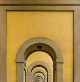 Arches in Florence. Arches on the long way besides the river Arno in Florence Royalty Free Stock Photography