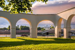 Through the arches of Gostiny Dvor. Is the Kremlin of Veliky Novgorod under the pink evening sky Stock Image