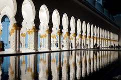 Arches of grand  mosque at night. Exteriors of Shaikh Zayed mosque in Abu Dhabi Stock Image