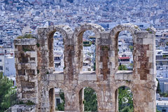 Arches of Herodion theater on Athens cityscape Royalty Free Stock Images