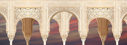 Arches in Islamic (Moorish)  style in Alhambra, Granada, Spain.  Stock Images
