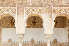 Moorish details in Alhambra,. Arches in Islamic Moorish style in Alhambra, Granada, Spain Royalty Free Stock Photo