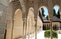 Arches in Islamic (Moorish)  style and tourists in Alhambra, Granada, Spain Stock Photo