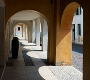The arches, Italy. Pass under the arches, gallery, Italy Royalty Free Stock Photo