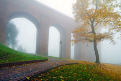 Arches of Kwidzyn castle in fog. Foggy scenery of Kwidzyn castle and cathedral, Poland Stock Image