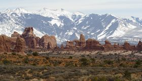 Arches Landscape and Mountains. Arches landscape with snow-capped mountain backdrop Stock Photo
