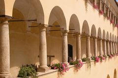 Arches at Mokrice Castle. A very nice view of a line of arches and colorful flower boxes along a covered walkway that is part of Mokrice Castle in Slovenia Stock Image