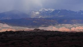 Arches National Park with La Sal Mountains. Slow pan stock footage