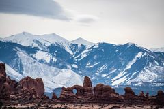 The white snow reflects the beauty. Arches National Park is about 1,700 meters above sea level, towering under the snow-capped mountains. The beauty of the snow stock images