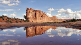 Arches National Park rock tower. Reflection on the surface of water Royalty Free Stock Image