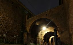 Arches at night in Rome Stock Image