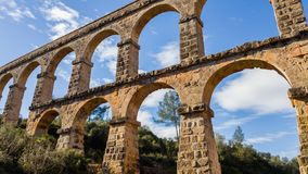 Arches of the old stone Roman aqueduct in Tarragona, Catalonia, royalty free stock images