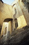 Arches of the Papal Palace, Avignon, France. Ached windows and corridors of the massive stone Papal Palace in Avignon, France stock photo